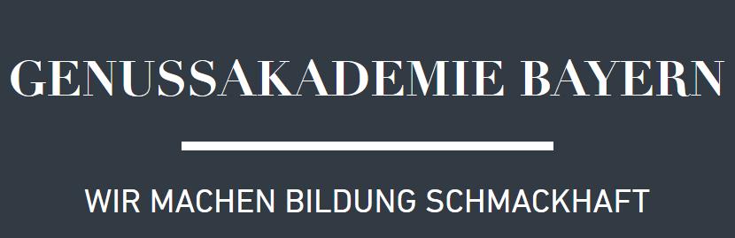 """Weiße Schrift auf Anthrazit-Hintergrund """"Genussakademie Bayern – wir machen Bildung schmackhaft."""""""