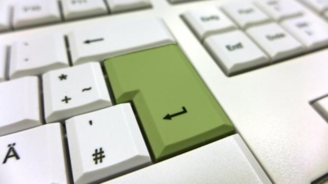 Tastatur mit grün gefärbter Enter-Taste